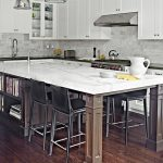 kitchen island with seating for 4 marble countertop shaker cabinet hardwood floors chairs built in bookshelves sink pendants backsplash traditional design