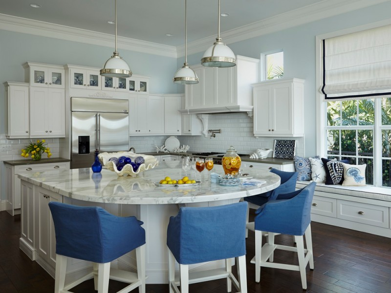kitchen island with seating for 4 marble countertops bench white cabinets hardwood floors subway tile backsplash sink pendants window ceiling lights beach style
