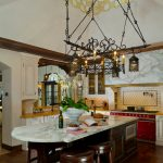Kitchen Island With Seating For 4 Marble Countertops Stools Coloured Appliances Sink Hardwood Floors White Cabinet Chandelier Subway Tile Backsplash Mediterranean Design