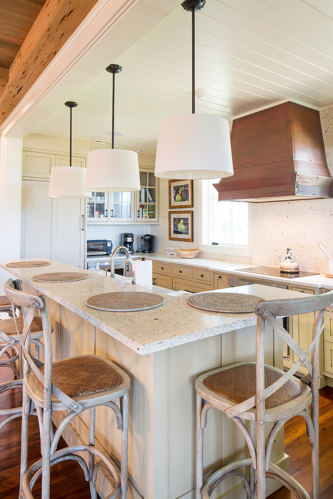 kitchen island with seating for 4 recessed panel cabinets white countertops chairs hardwood floors pendants sink subway tile backsplash decorations farmhouse design