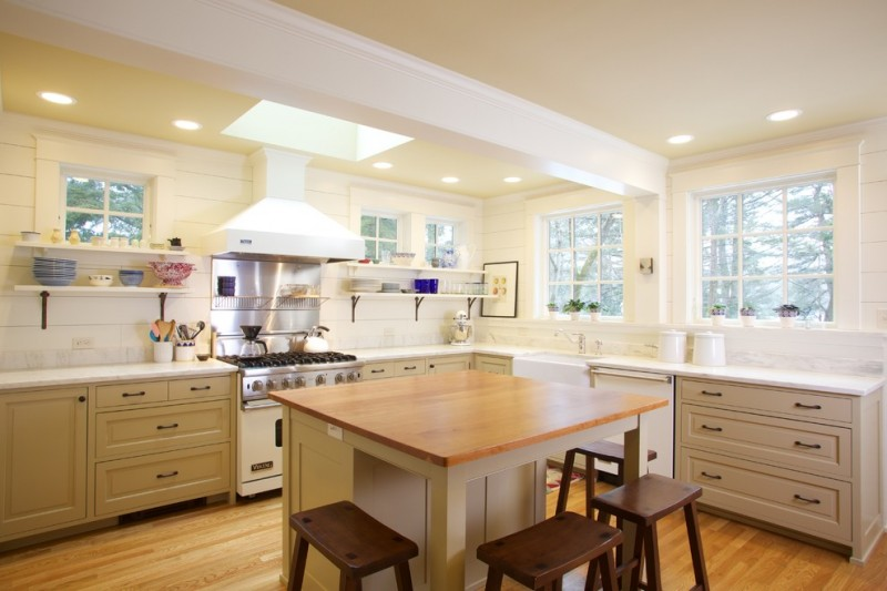 Kitchen Island With Seating For 4 Wood Countertop Raised Panel Cabinets Ceiling Lights Hardwood Floors Hanging