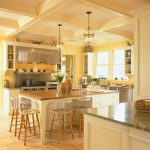 Kitchen Island With Seating For 4 Wood Countertops High Chairs White Cabinets Pendants Stainless Steel Appliances Concrete Floors Sink Traditional Design
