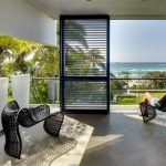 Large Balcony Enclosed With Glass Rail, Added Covers With Black Rail Silding Door