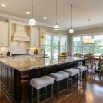 Large Kitchen Islands With Seating And Storage Chairs Wood Floor Faucet Sink Lamps Windows Transitional Room