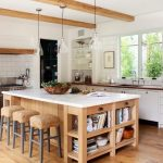 large kitchen islands with seating and storage stools books stove drawers window lamps shelves farmhouse room