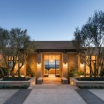 Large Southwestern Beige One Story Adobe Exterior Home With A Flat Roof Black And Brown Concrete Tile Floors Glass Doors