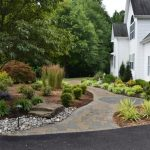Large Traditional Yard Landscape With A Garden Path And Natural Stone Pavers Deck Wooden Wall Painted In White Glass Windows