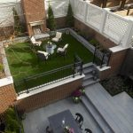 lattice fence designs brick walls chairs tables stone pavers metal gate flower vase traditional design