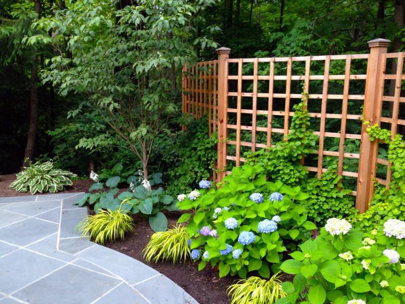 lattice fence designs garden stone pavers plants sconces traditional design