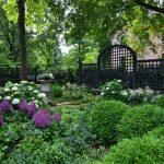 lattice fence designs garden urn plants flowers pavers traditional design