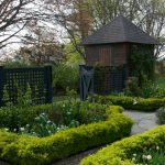 lattice fence designs panels stone pavers roofs wall small building garden plants traditional design