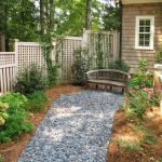 lattice fence designs stone pavers bench garden windows brown walls roofs traditional design