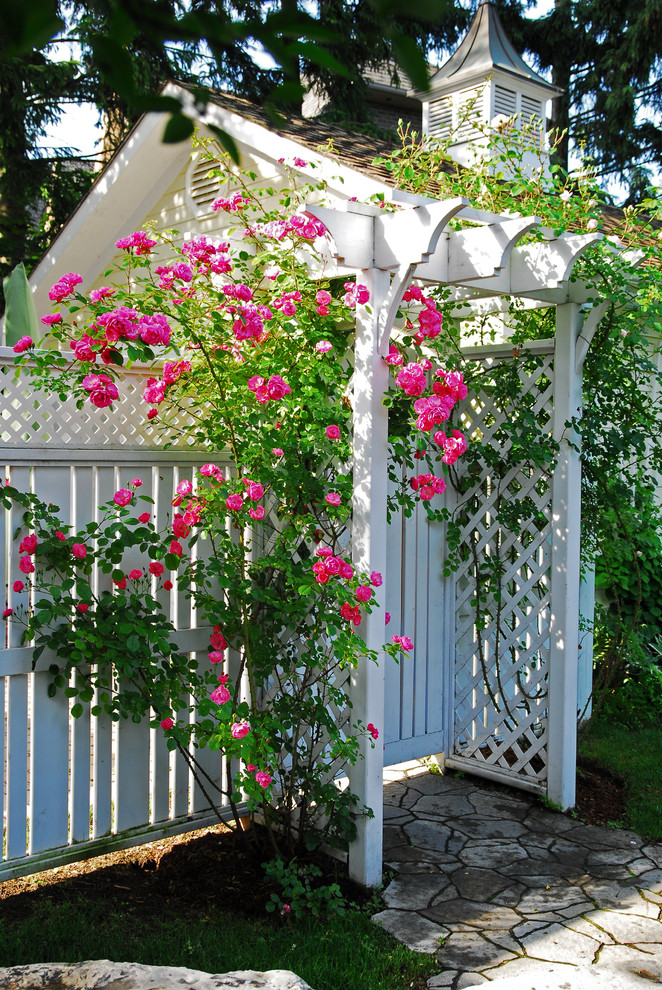 lattice fence designs stone pavers roof pink roses grass traditional design