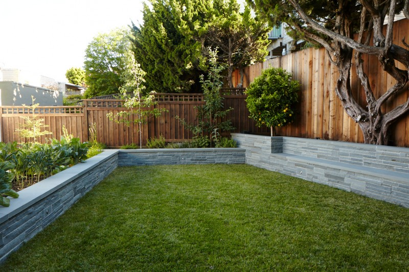 lattice fence designs wood vertical board stone low wall grass trees contemporary design