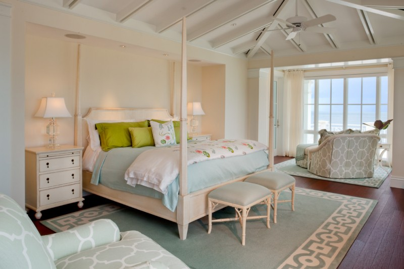 light blue and white bed treatment idea with green shams light peach bed frame in classic style light peach walls dark hardwood floors white bedside tables with drawers grey area rug with white motif