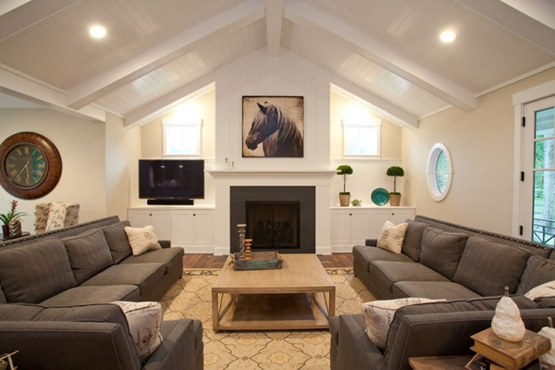 living rooms with sectionals clock pillows table tv windows plants contemporary living room