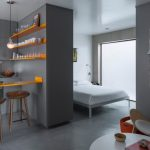 living spaces bedroom sets bed couch stools narrow table cabinets artwork pendants hanging shelves grey walls contemporary design