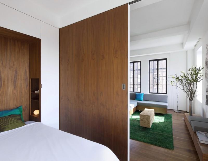 living spaces bedroom sets bed room divider sectional sofa bench carpet hardwood floors vase ottoman windows built in shelf modern design