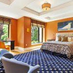 Living Spaces Bedroom Sets Bed Sidetable Couches Chair Basket Carpet Hardwood Floors Orange Walls Large Windows Blinds Pendant Desk Artwork Contemporary Design