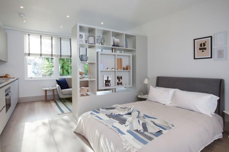 living spaces bedroom sets bed two way shelving cabinet ceiling lights hardwood floors wall decorations sofa sidetables carpet window blinds scandinavian design