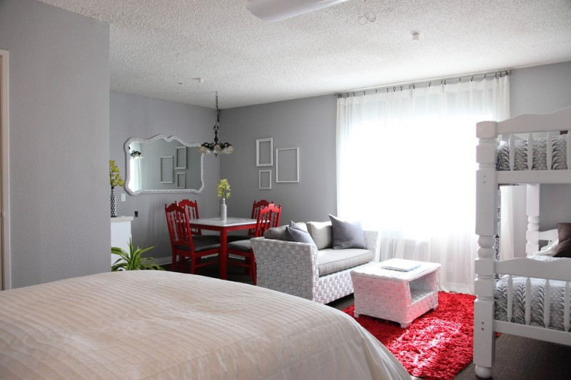 living spaces bedroom sets beds hardwood floors sofa table ottoman chairs carpet decorative mirror chandelier sidetable eclectic design