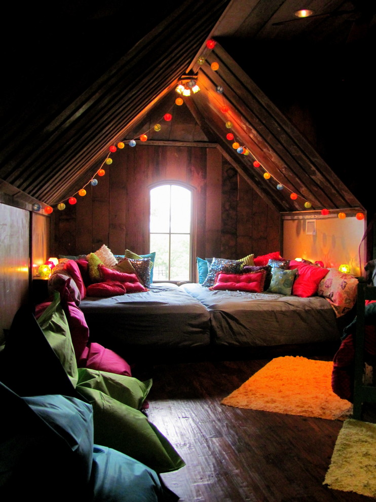 living spaces bedroom sets hardwood floors wood walls bed throw pillows ceiling lights bean bags carpets window string lights eclectic design