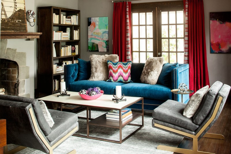 living spaces couches chairs table pillows curtains carpet bookshelves books beautiful floor painting farmhouse room