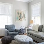 living spaces couches painting flowers chair window small table lamp white ceiling pillows transitional room