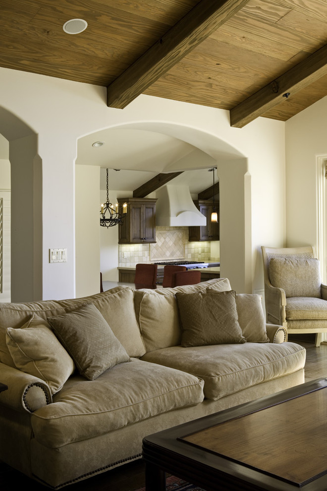 living spaces couches table armchair pendants cabinets wood ceiling chairs mediterranean design