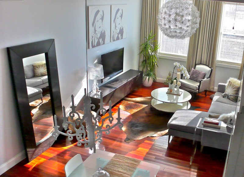 living spaces sectionals sofa tables decorative pendant mirror hardwood floor armchair sideboard tv chairs artwork lamp carpet candleholder modern design