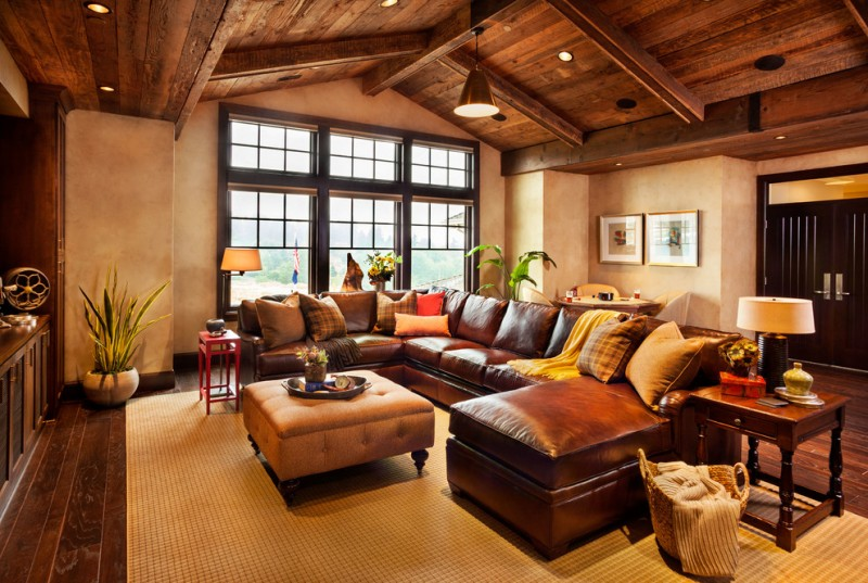 living spaces sectionals wood floor small tables lamps ottoman table big window flowers rustic room