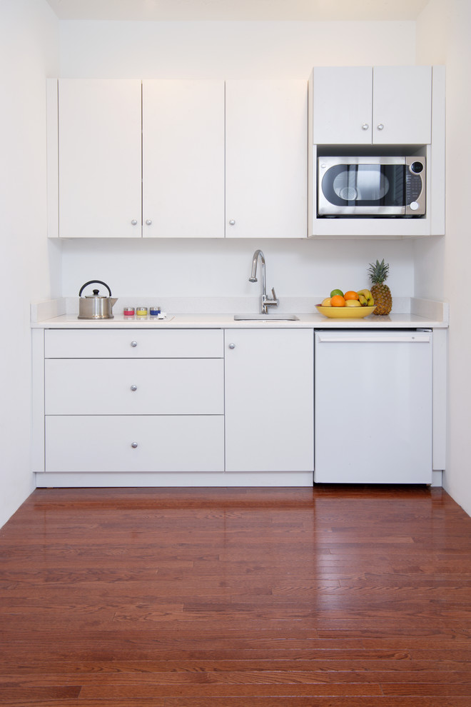 mini kitchen units beautiful floor sink faucet drawers cabinets oven bright room white walls modern cooking chamber