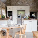 mini kitchen units chairs tables flowers island cabinet fridge oven stone walls lamp drawers farmhouse kitchen