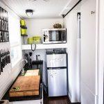 mini kitchen units dark wood floor countertop fridge oven faucet shelves eclectic room