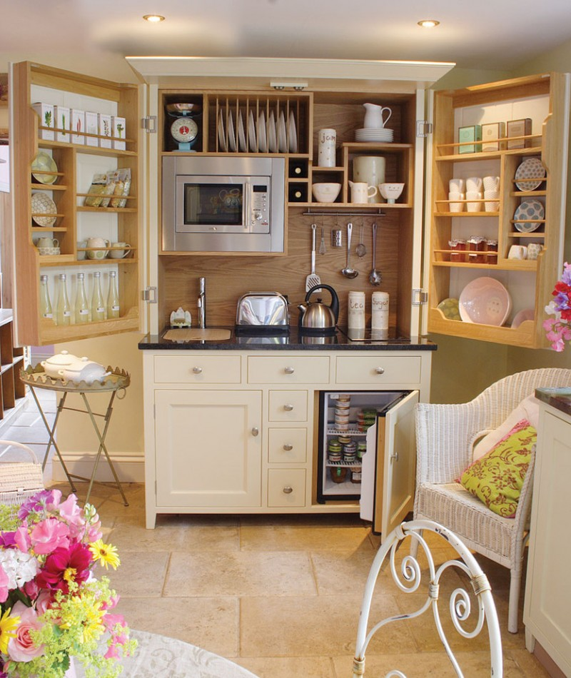 mini kitchen units flowers chair shelf faucet storage space ceiling lights small table traditional style room