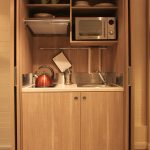mini kitchen units shelves oven plates cups fan stove faucet sink modern style room
