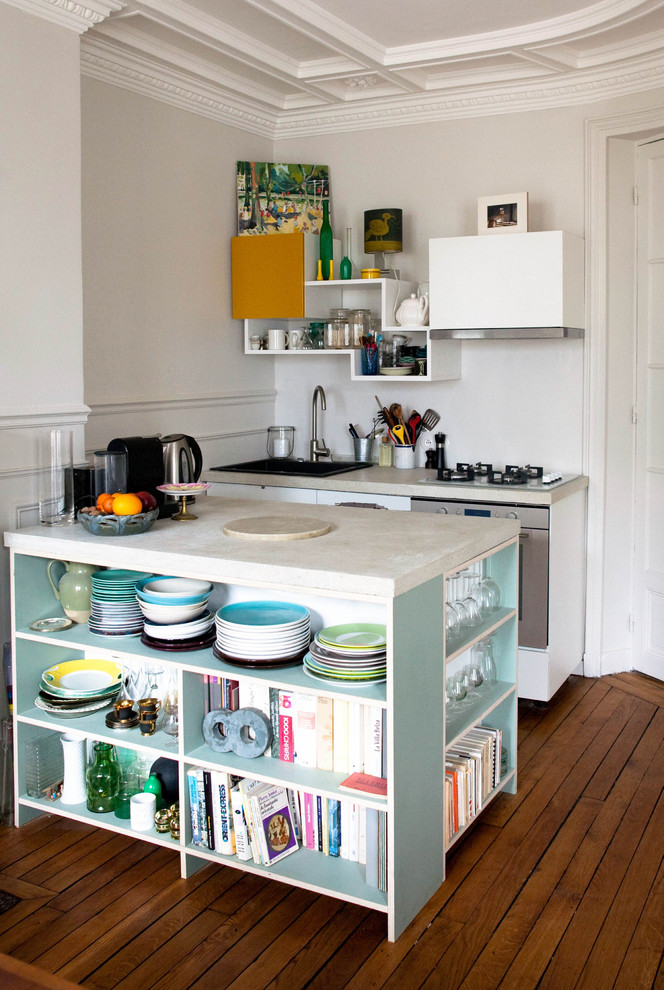 mini kitchen units wood floor shelves books island plates wall storage faucet stove contemporary style room