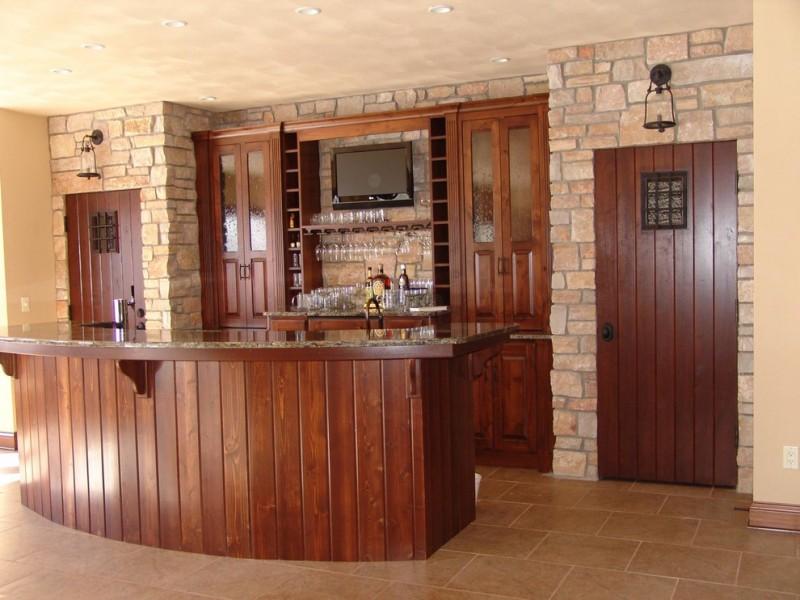 mission style home bar idea with dark hardwood slab doors dark hardwood slab bar table with granite top shelf for wine glass recessed wine storage units custom TV set