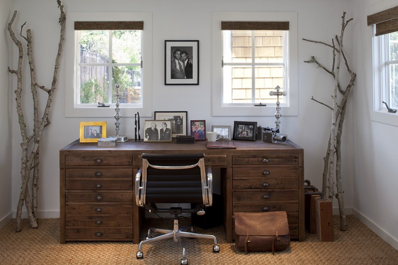 mission style home office idea dark hardwood working table modern working chair textured & knitted area rug clean white walls tree trunk decorations