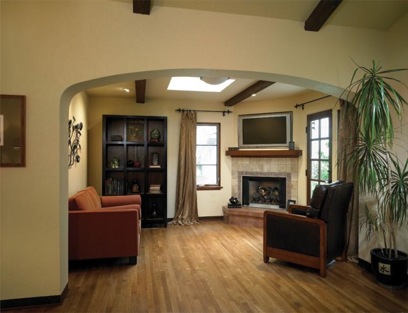 mission style living room furniture display rack armchair sofa fireplace hardwood floors plant pot tv bench windows ceiling lights mediterranean design
