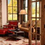mission style living room furniture leather chair ottoman hardwood floor table sofa lamp column windows rustic design