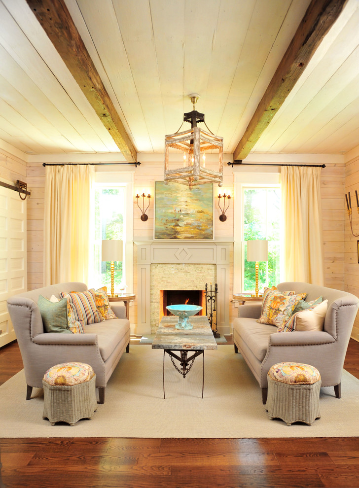 mission style living room furniture ottomans coffee table sofa rug hardwood floor pendant sconces sidetables lamps windows curtains transitional design