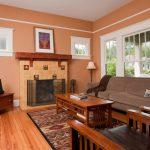Mission Style Living Room Furniture Sideboard Table Armchairs Sofa Fireplace Carpet Hardwood Floors Windows Tv Standing Lamp