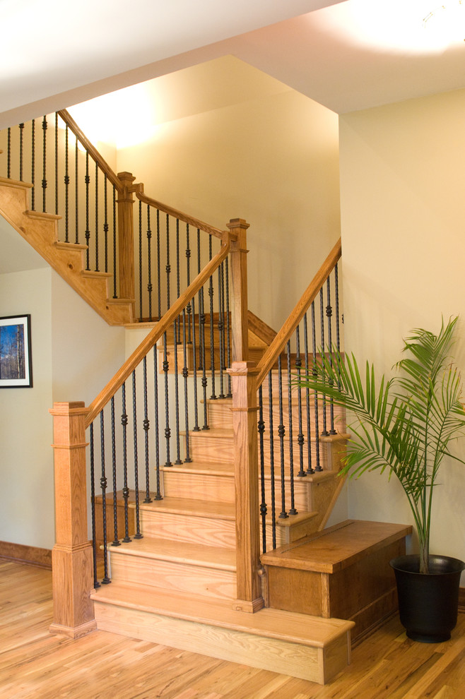 mission styled staircase made of oak and stained wrought iron rails