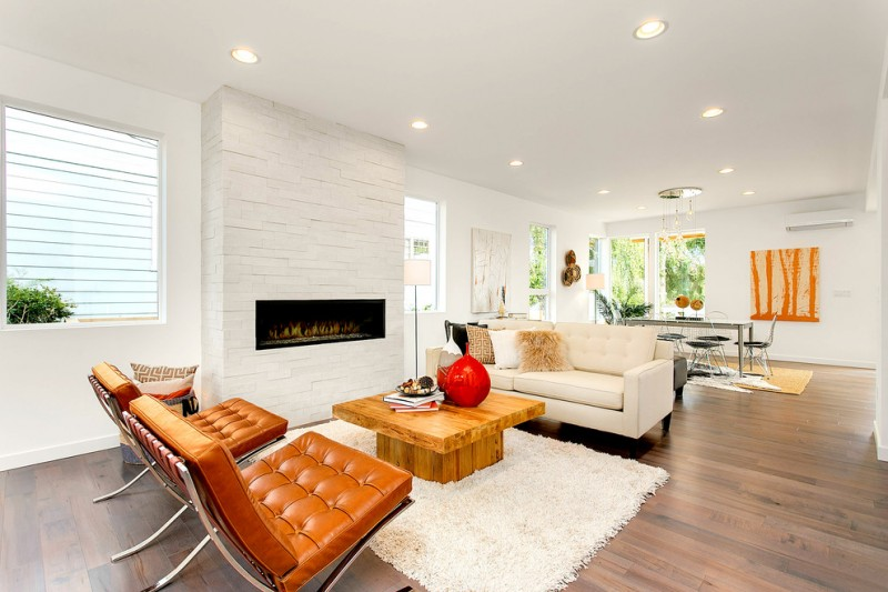 modern accent chairs in yellow white sofa wall and rug wooden coffee table light toned wooden floor ribbon brick fireplace