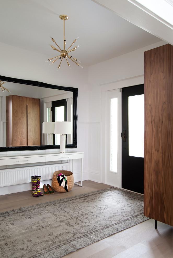 modern entryway table hardwood floors carpet chandelier radiator drawers wardrobe lamp shoes basket transitional design