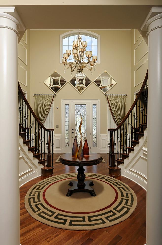 modern entryway table hardwood floors carpet chandelier staircaase door windows curtain traditional design