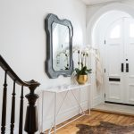 Modern Entryway Table Hardwood Floors Rug Double Door Staircase Mirror Golden Vase Transitional Design