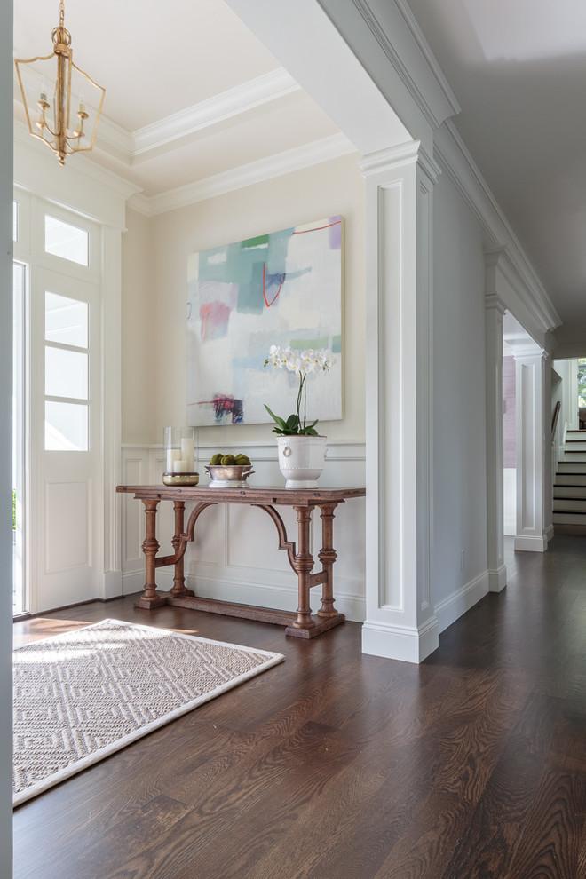 modern entryway table hardwood floors rugs pendant artwork vases traditional design