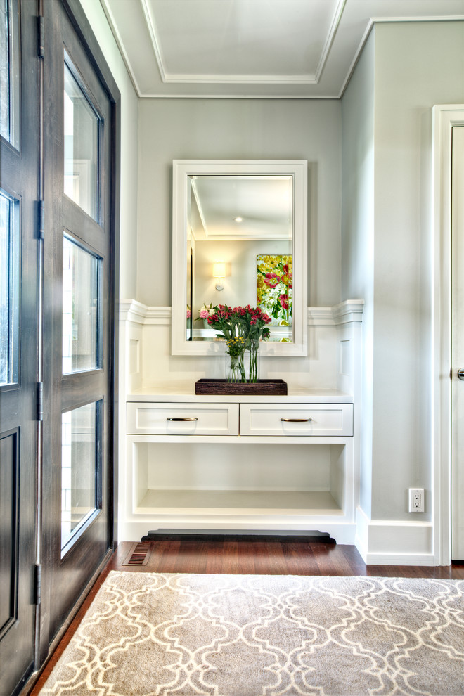 modern entryway table mirror hardwood floors carpet drawers double doors vase transitional design